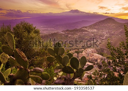 Mount Etna in Sicily seen from Taormina;  prickly pear on foreground - stock photo