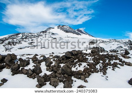 Mount Etna peak with snow, Sicily, Italy - stock photo