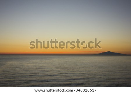 Mount Etna Sicily at sunset from the sea - stock photo