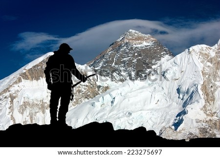 Mount Everest and silhouette of man - trek to everest base camp - Nepal - stock photo