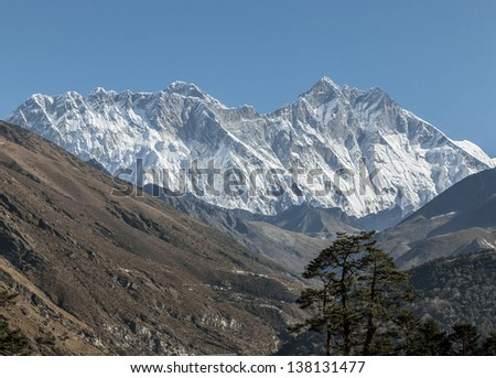 Mount Everest (8848 m) and Lhotse (8511 m) in the morning (view from Tengboche monastery) - Nepal, Himalayas - stock photo