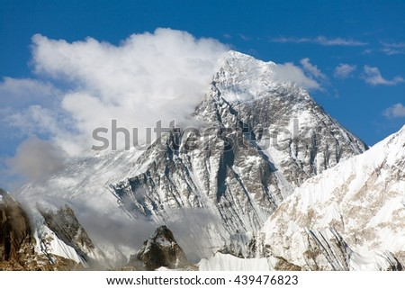 Mount Everest, panoramic view of Everest with beautiful clouds on the top - Everest area, Sagarmatha national park, Khumbu valley, Nepal  - stock photo