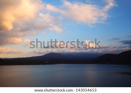 Mount Fuji and Lake Motosu at dusk. - stock photo