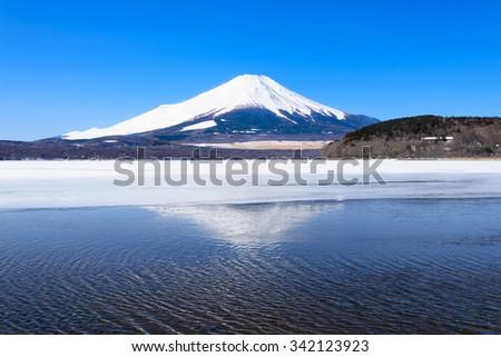 Mount Fuji reflected in Lake Yamanaka, Japan. - stock photo