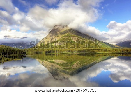 Mount Grinnell Reflecting in Swiftcurrent Lake - Glacier National Park - Montana - stock photo
