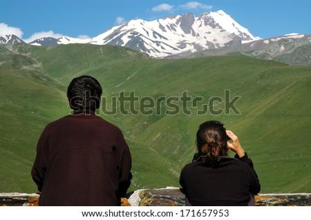 Mount Kazbek at spring. Caucasus mountains, Georgia - stock photo
