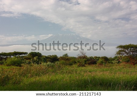 Mount Kilimanjaro as seen from Masai Mara National Reserve in Kenya. - stock photo