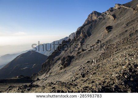 Mount Meru near Arusha in Tanzania. Africa. Mt Meru is located 60 kilometres west of Mount Kilimanjaro. - stock photo
