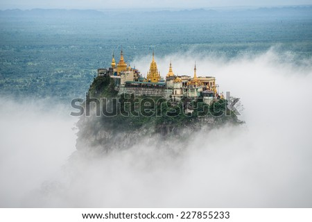 Mount Po-pa with fog, the old volcano in Myanmar - stock photo