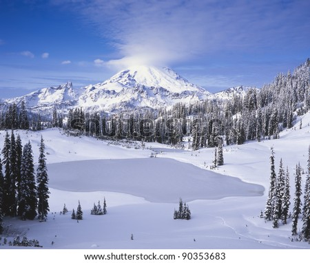 Mount Rainier and Tipsoo Lake in winter; Mount Rainier National Park; Washington State, USA - stock photo