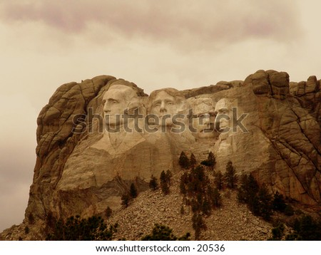 Mount Rushmore black and white warm toned to look like an old sepia toned photo. - stock photo