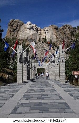 MOUNT RUSHMORE, SOUTH DAKOTA - SEPTEMBER 26: The Grand View Terrace approach to historic Mt. Rushmore on September 26, 2008 in South Dakota. 400 workers carved the 60 foot high sculpture. - stock photo