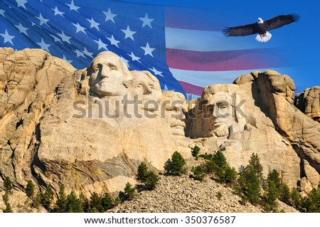 Mount Rushmore with American flag background and flying bald eagle in Black Hills, South Dakota, U.S.A. - stock photo