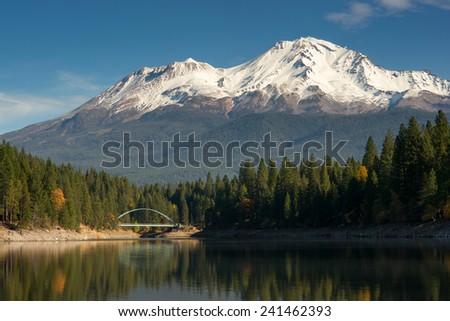Mount Shasta and Suspension Bridge standing above Lake Siskiyou - stock photo