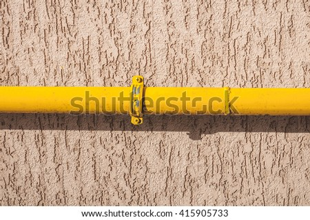 Mount the gas pipe to the wall - stock photo