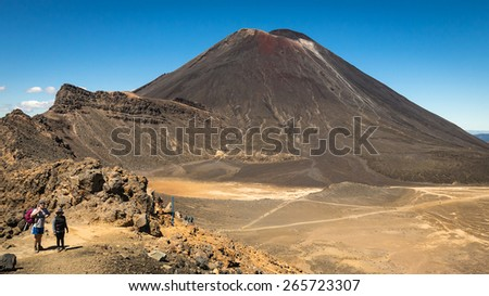 Mount Tongariro, New Zealand - January 12:  Hikers enjoy spectacular views from the top of Mount Tongariro volcano.  The Tongariro Crossing is regarded by many as the New Zealand's best one-day walk. - stock photo