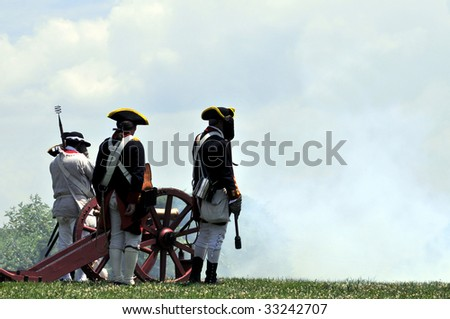 MOUNT VERNON - July 4: An old cannon and rifles are fired to mark Independence Day in Mount Vernon, on July 4, 2009. Mount Vernon is George Washington's former home and a popular tourist attraction. - stock photo