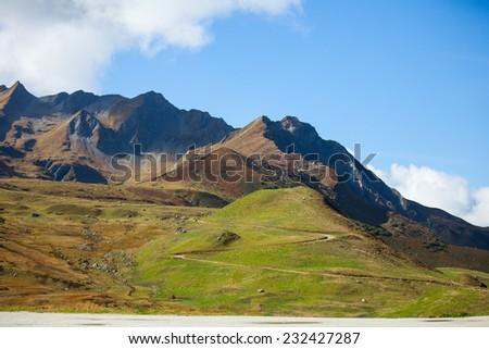 Mountain alpine road - stock photo
