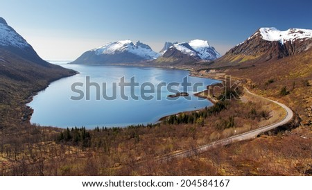 Mountain and fjord in Norway - Senja - stock photo