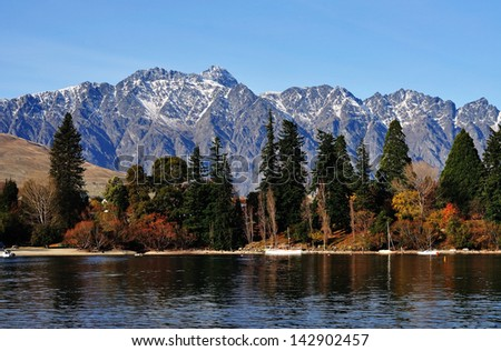 Mountain and lake in Queenstown - stock photo