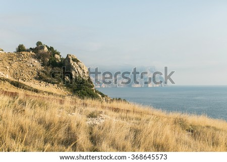 mountain and sea in the Crimea. Cape Fiolent in gold autumn - stock photo