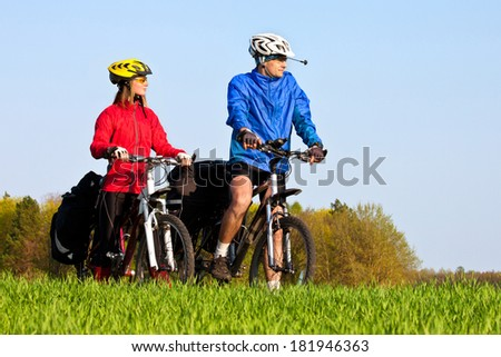 mountain bike couple cycling outdoors and leading a healthy lifestyle - stock photo