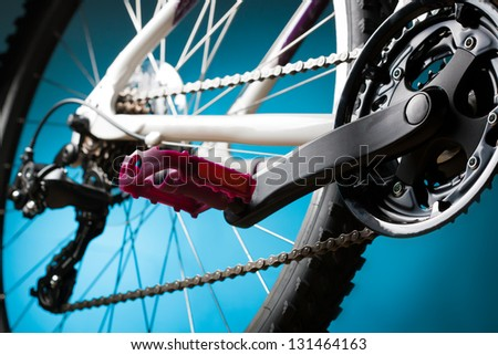 mountain bike, front sprocket and pedal - stock photo