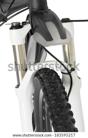 mountain bike front wheel suspension fork over white background - stock photo