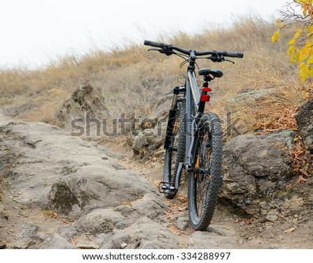 Mountain Bike on the Beautiful Autumn Rocky Trail. Active Lifestyle and Extreme Sports Concept. - stock photo
