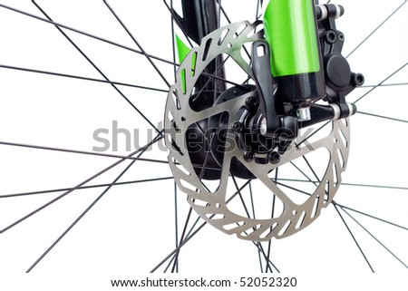 Mountain bike wheel with closeup on hydraulic disc brake isolated on white - stock photo