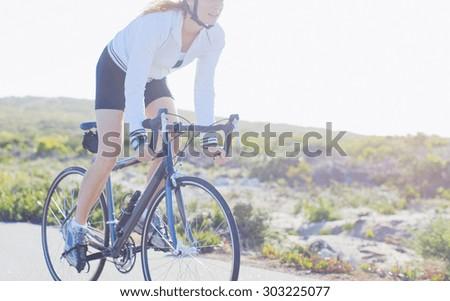 Mountain bike woman sitting on a bicycle  - stock photo