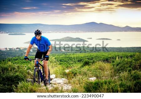 mountain biker riding on Croatia - stock photo