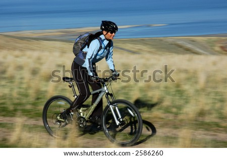 Mountain biking action blur - stock photo