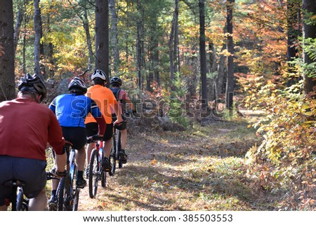 Mountain biking in the Fall - stock photo