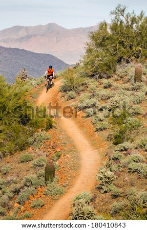 Mountain Biking on Desert Trail - stock photo