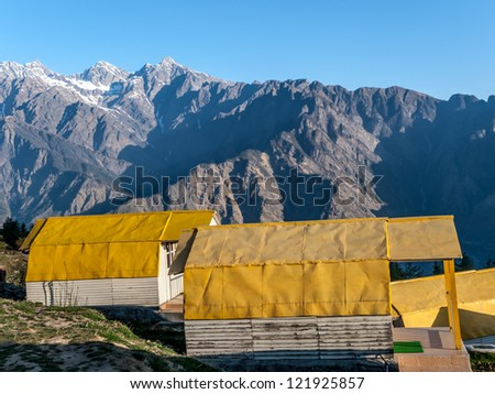 Mountain camp on sunrise in the Himalayas - Auli (ski destination), India. - stock photo