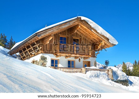 Mountain chalet in alps - stock photo