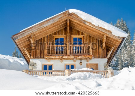 Mountain chalet in the alps in winter - stock photo