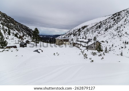 Mountain chalet in the winter - stock photo