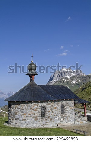 Mountain chapel at the summit of the Klausen Pass in the canton of Uri - stock photo