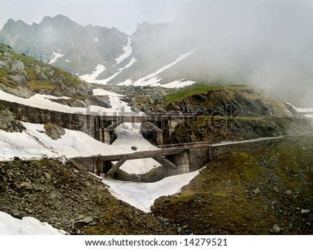 mountain cliff in a misty day of winter - stock photo