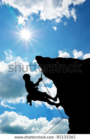 Mountain climber on the top. - stock photo
