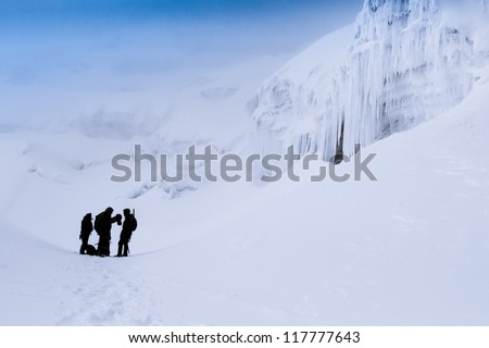Mountain climbers at the slopes of Cotopaxi volcano in Ecuador - stock photo