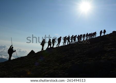 mountain climbing team - stock photo