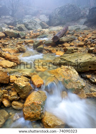 Mountain creek amongst yellow stone. Composition of the nature - stock photo