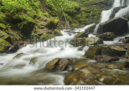Mountain fast flowing river Shipot waterfall stream of water in the rocks - stock photo