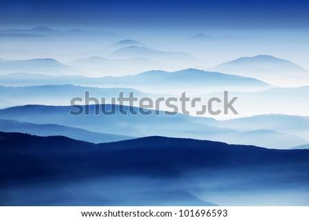 Mountain foggy landscape - stock photo