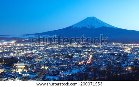 mountain fuji in winter from Fujiyoshida town  - stock photo