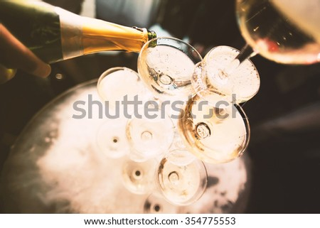 mountain glasses of champagne, a bottle of stream - stock photo