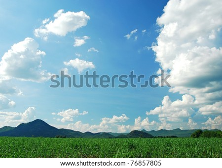 Mountain green grass and blue sky nature for backgrounds - stock photo